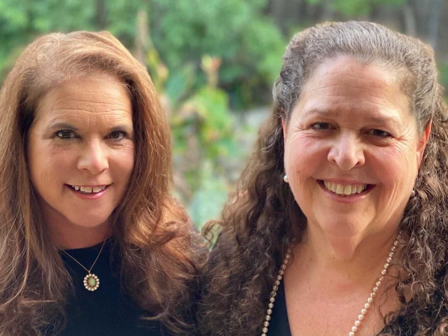 Randi Emerman (left) and Carol Marshall (right), co-founders of Film Fest 919, smile together for a portrait. Photo courtesy of Carol Marshall.