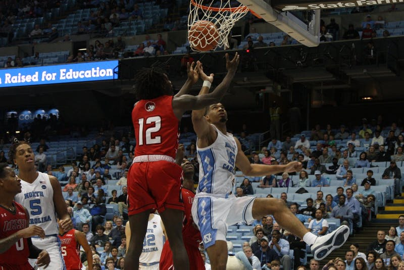 Junior guard Garrison Brooks (15) goes up for the ball during the exhibition game against Winston Salem State in the Smith Center on Friday, Nov. 1, 2019. UNC beat WSSU 96-61.