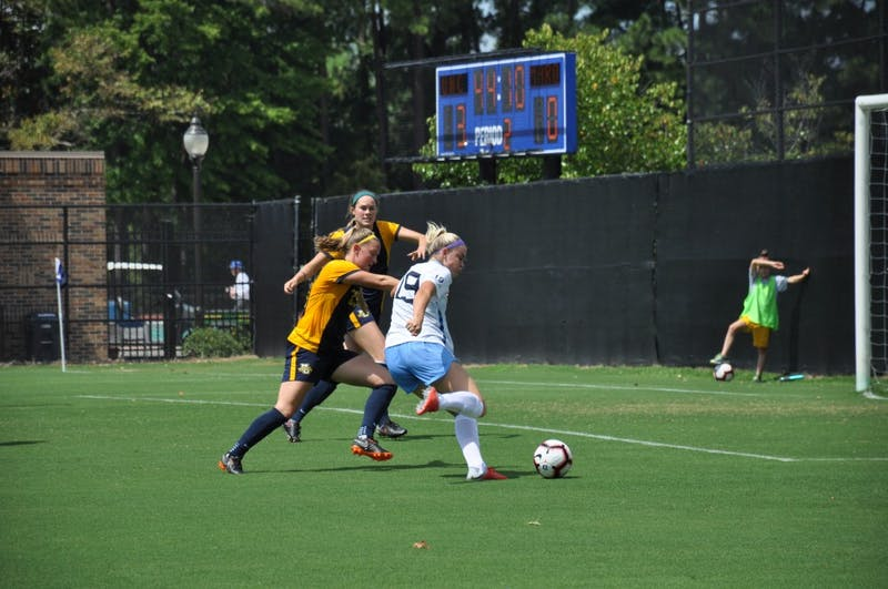 Forward (19) Alessia Russo shoots during Sunday's game against Marquette.
