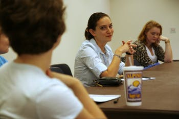 Ph.D neurobiology student Rebecca Balter (center) listens to a peer speak at the LGBTQ Center's roundtable discussion Wednesday.