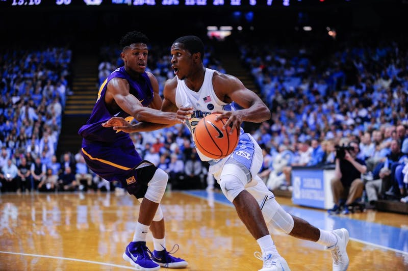 Junior Kenny Williams (24) drives to the basket against UNI.