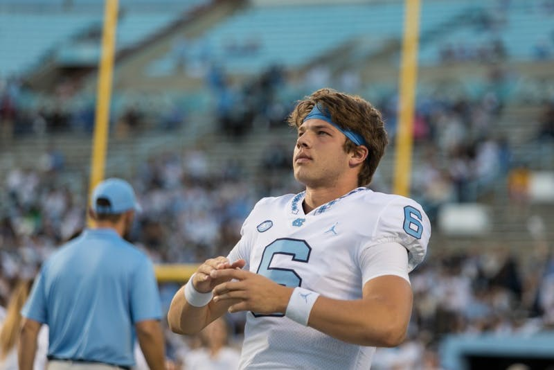 First-Year Quarterback Cade Fortin (6) looks across the field before the Tar Heels' 22-19 loss against Virginia Tech on the night of Saturday, October 13, 2018 in Keenan Memorial Stadium in Chapel Hill, NC.