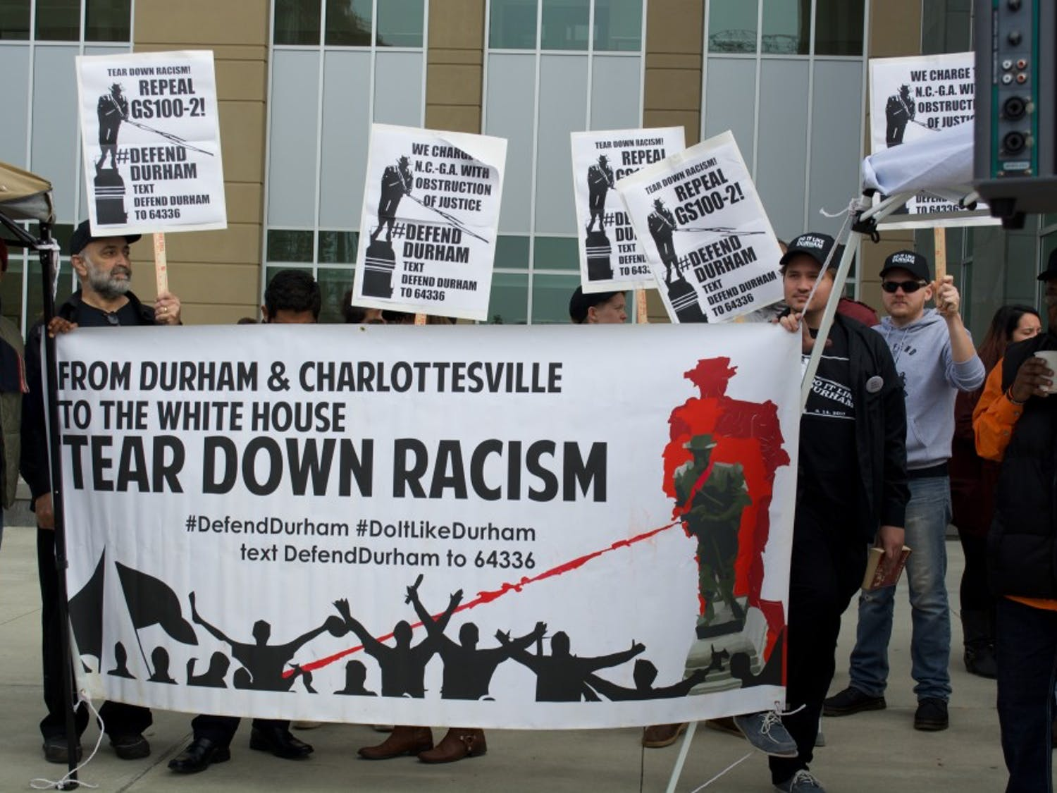 Protesters from Defend Durham, a local activist organization, demonstrated outside the county courthouse as protesters awaited their verdicts Dec. 5. The demonstration included speeches, as well as a sketching station for people to facilitate replacement statue ideas.