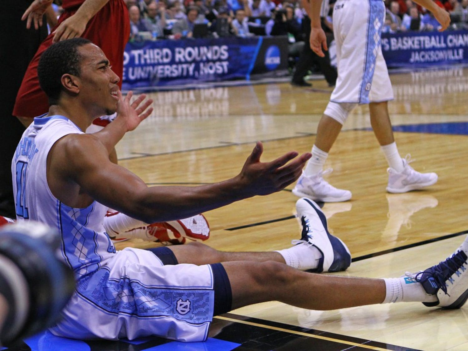 UNC forward Brice Johnson (11) reacts to a call in Saturday's game against Arkansas.The Tar Heels defeated the Arkansas Razorbacks, 87-78, on Saturday in Jacksonville, Fla.