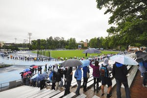 Students wait outside of Carmichael Arena for tickets to President Obama's Tuesday speech in a line that spills onto Fetzer Field and loops around the track.