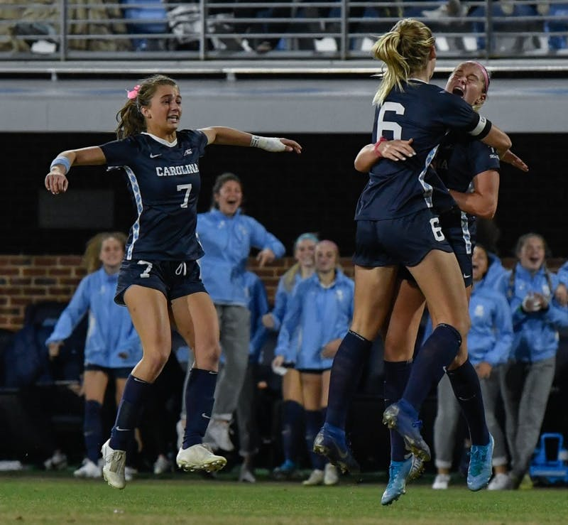 Taylor Otto (6) and Julia Dorsey (7) celebrate Alessia Russo's (19) goal that  led to North Carolina defeating Colorado 1-0 at Dorrance Field in the second round of the NCAA Women's soccer tournament.