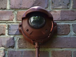 """Cameras have been installed on Graham Memorial Hall and Hyde Hall to provide surveillance to the statue of """"Silent Sam"""" on Monday morning Sept. 14. The camera on Graham Memorial can be found in the corner of the building, notable by its red piping."""