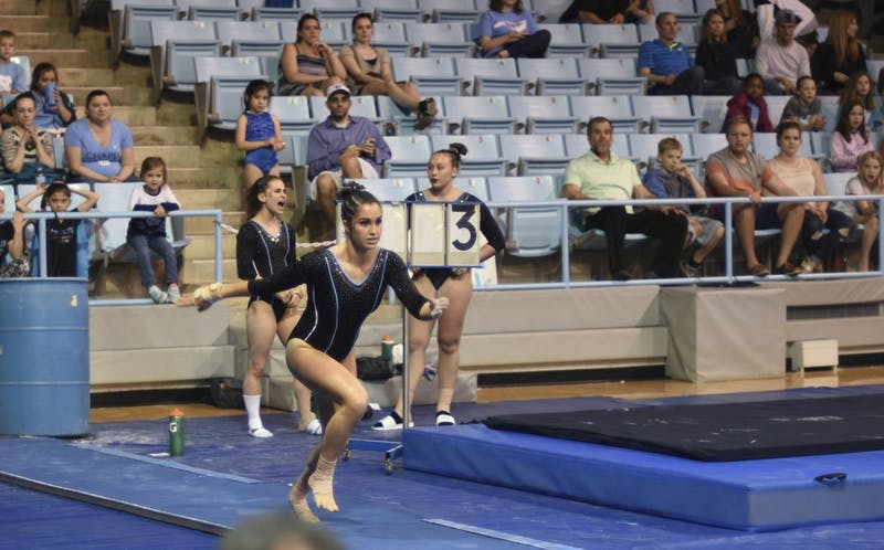 Christina Pheil, an all-around senior, competing on the vault on senior night.