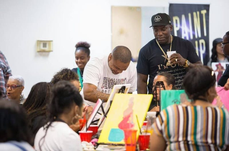 Artist Justin Q. Young (center) at a Paint n' Sip event held by his company. The House in Durham is hosting an Affirmation Paint Night this Saturday, Oct. 12, 2019 from 7-9 p.m. Photo courtesy of Courtney Jones.