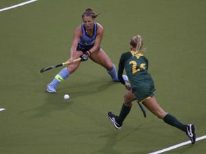 Senior midfielder Ashley Hoffman (13) competes for the ball against William & Mary forward Ashley Drum (26) during the first round of the NCAA Tournament on Friday in Karen Shelton Stadium. UNC field hockey advances to the second round of the NCAA Tournament after defeating William & Mary 4-0.