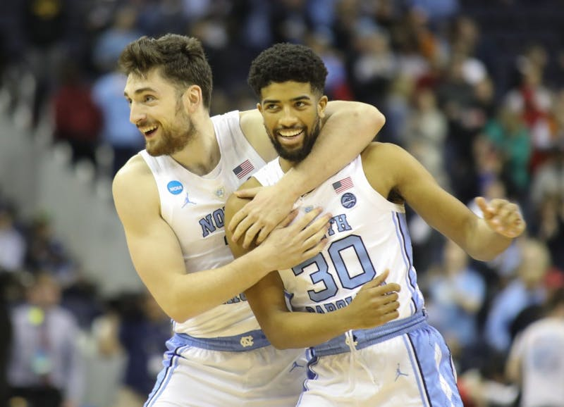 Sophomore guards Andrew Platek (3) and KJ Smith (30) celebrate the win against Washington in the second round of the NCAA tournament at Nationwide Arena in Columbus, OH on Sunday, March 24, 2019. UNC defeated Washington 81-59.