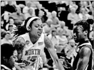 """Despite combining for only 11 fouls in the first half"""" the physical play between the Tar Heels and Boilermakers defined the game from the onset."""