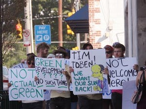 About 15 area residents stood in non-violent protest against Greenbridge Condominiums Saturday evening.