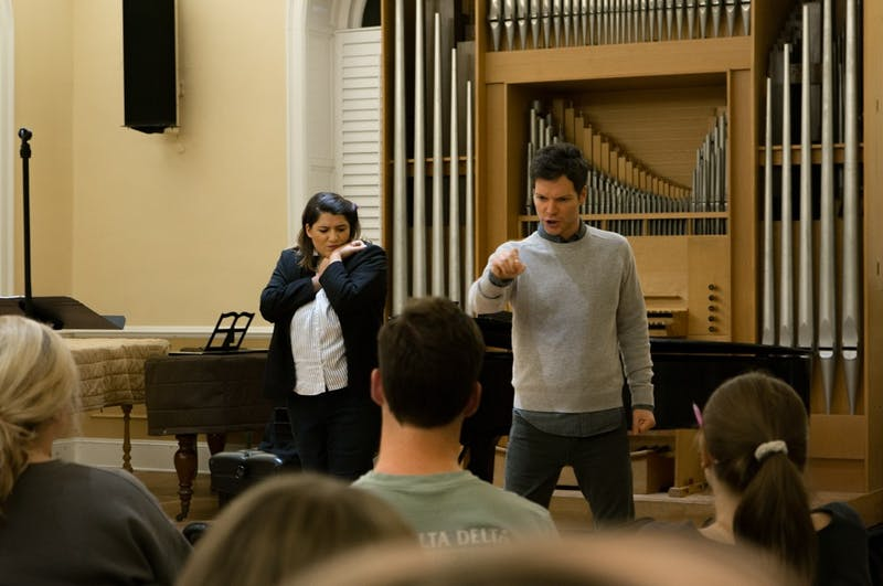 """Marc Callahan, playing Hannah Before in the opera piece """"AS ONE,"""" and Melina Jaharis, playing Hannah After, practice for their performance at the open rehearsal in Person Hall on Wednesday, Oct. 30, 2019. """"AS ONE"""" is part of the Countering Hate Initiative and is about a transgender woman grappling with her identity as she goes through various stages of life."""