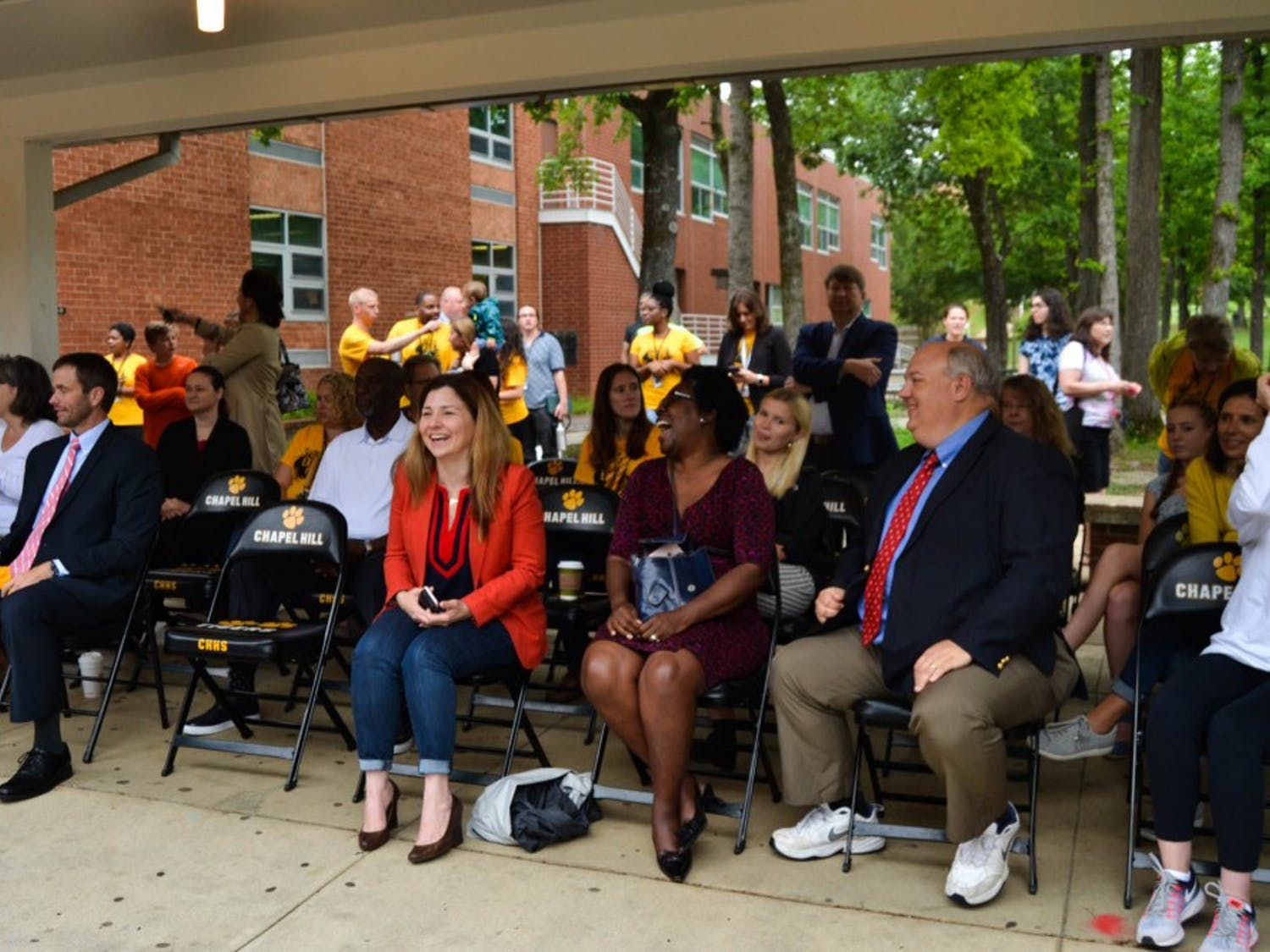 City officials, teachers, students and reporters gather in the Chapel Hill High courtyard to watch the groundbreaking for the new renovations for the school.