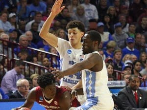 North Carolina wingsJustin Jackson (44) and Theo Pinson (1) use their length to disrupt the Arkansas ball-handlerin UNC's second-round win over the Razorbacks.