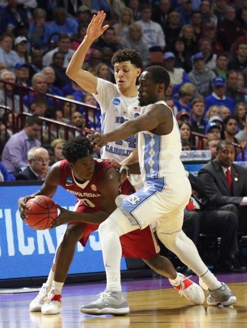 North Carolina wings Justin Jackson (44) and Theo Pinson (1) use their length to disrupt the Arkansas ball-handler in UNC's second-round win over the Razorbacks.