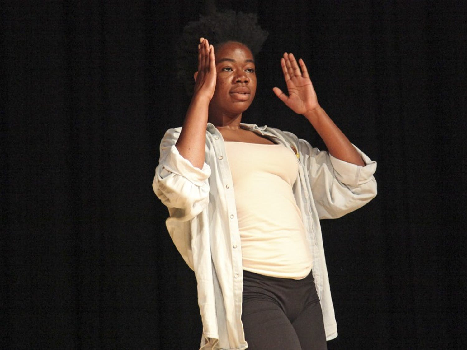 Damola Akintunde performs the opening dance during the Body Politics talk in in the Sonya B. Hayes Stone Center on Wednesday night.
