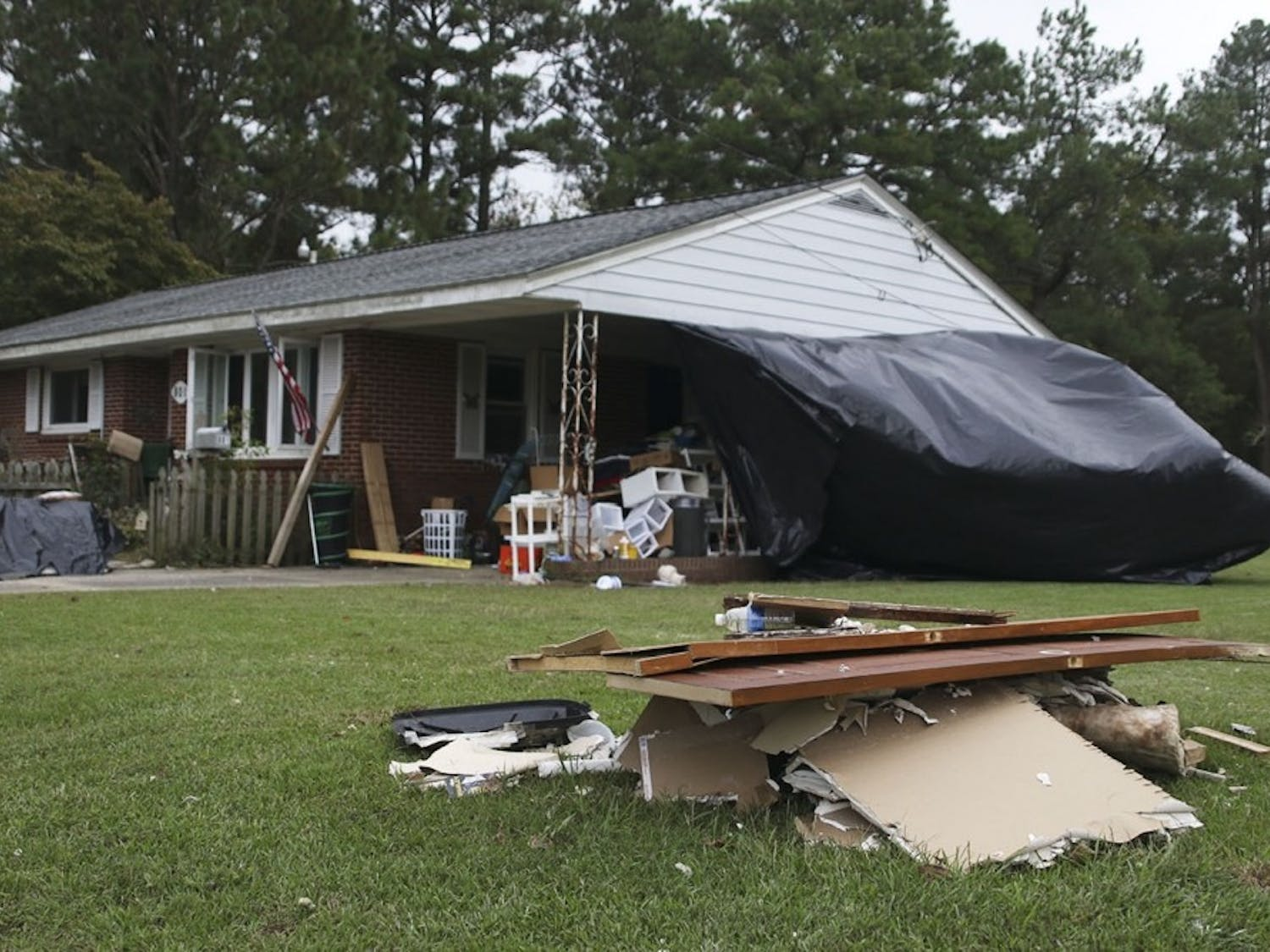 A home in Windsor airs out along with all its contents after it was hit in 2016 by Hurricane Matthew.