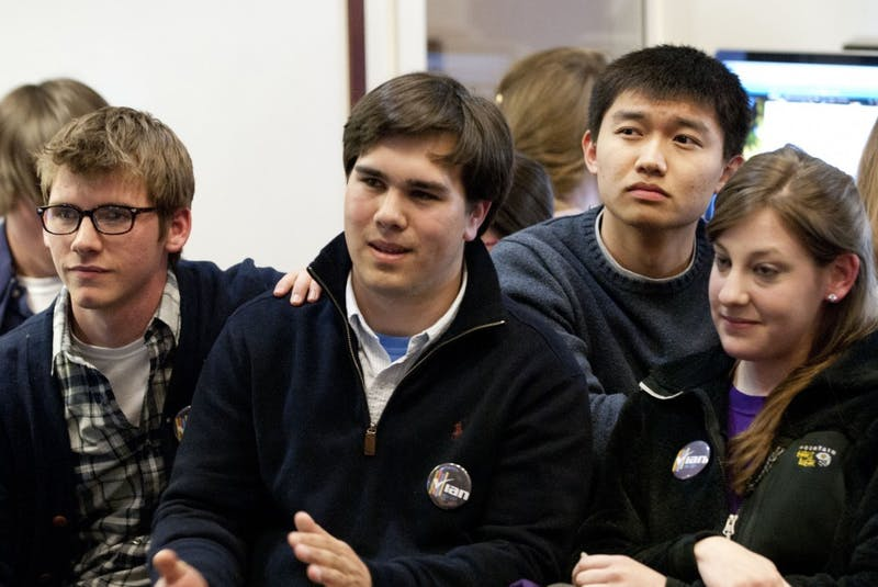 Ian Lee and his supporters react to the news of Mary Cooper's 62 percent student body president win.