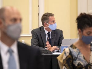 UNC Chancellor Kevin M. Guskiewicz (Center), speaks during the UNC Board of Trustees full board meeting held at The Carolina Inn using COVID-19 protocols limiting the in-person attendance to 25 and having some participate via Zoom. November 12, 2020.(Jon Gardiner/UNC-Chapel Hill)