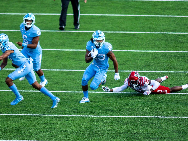 UNC sophomore running back Josh Henderson (23) rushes in Kenan Stadium Oct. 24, 2020. The Tar Heels beat the Wolfpack 48-21.