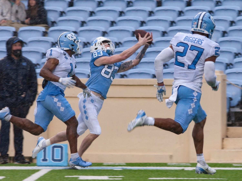 UNC sophmore tight end Justin Olson (83) hauls in a pass during Carolina Football's spring game on Aprril 24, 2021 at Kenan Stadium
