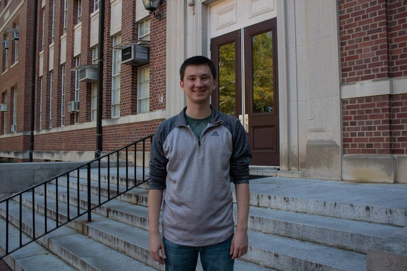 Jackson Trice, a senior economics major, stands in front of Gardner Hall, home to UNC's department of economics on Wednesday, Nov.6, 2019.