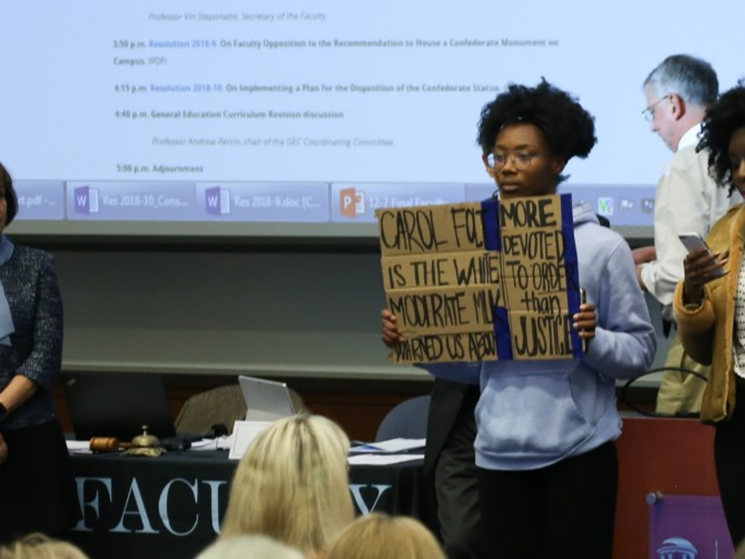 Chancellor Carol Folt looks on as undergraduate students Angum Check and Tamia Sanders take the stage to show their disapproval of the proposal given by Folt about the re-erection of Silent Sam on UNC's campus.