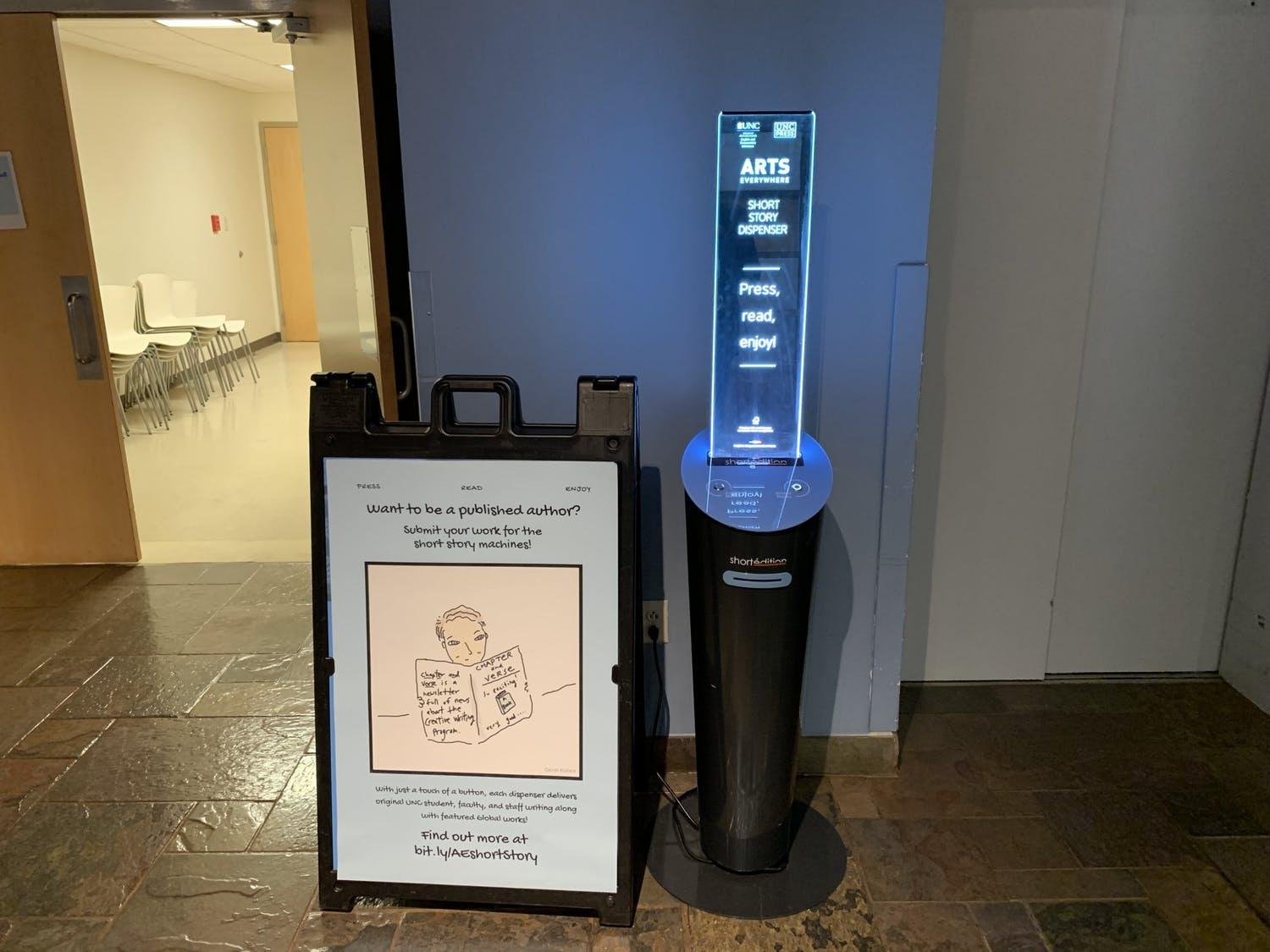 There are eight short stories dispensers across campus like this one in the Student Union. The short story dispensers feature the work of UNC students and local authors.