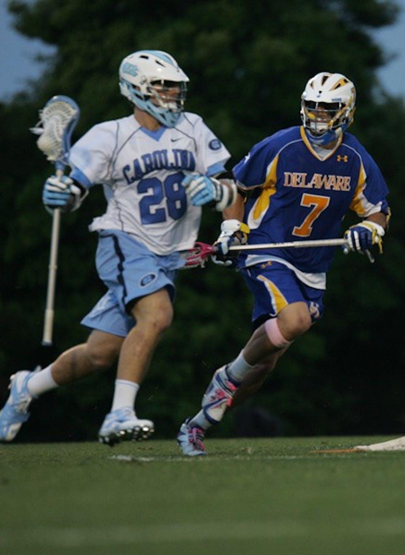 UNC midfielder Matt Davie is defended by Delaware's John Austin in the NCAA Tournament Sunday. DTH/Stephen Mitchell