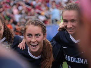 UNC senior defender Julia Ashley (16) leads a huddle to hype her teammates up before Sunday's National Championship game against FSU. UNC lost 0-1.