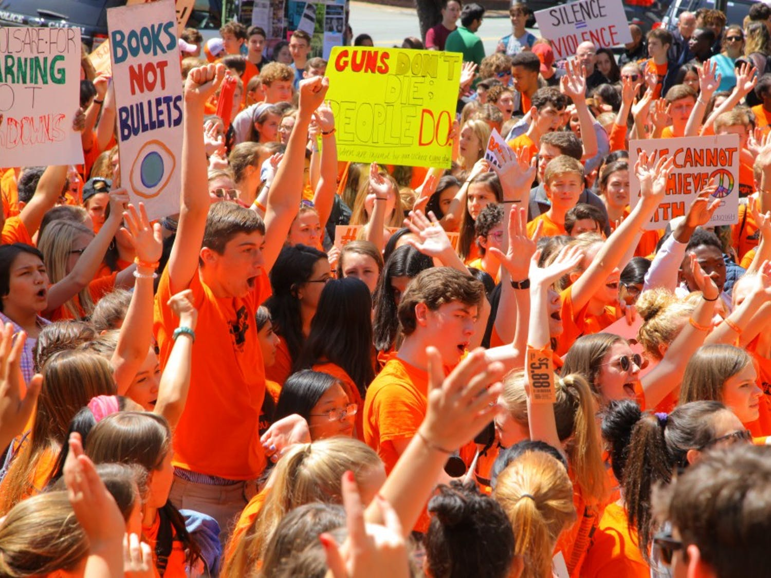 High school students from the Chapel Hill-Carrboro area gather on April 20 at Peace and Justice Plaza on the anniversary of the Columbine massacre to demonstrate solidarity and push gun reform.