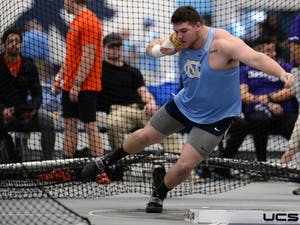 Daniel McArthur competes in the shot put at the Eddie Smith Field House on Saturday, January 11, 2020. Photo courtesy of Jeff Camarati/UNC Athletic Communications.