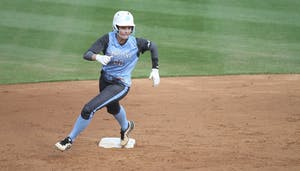 Sophomore first-baseman Jenna Kelly rounds second base during UNC's three-game series vs. Florida State. UNC lost all three games.