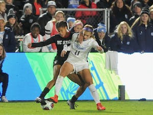 North Carolina midfielder/defender Emily Fox keeping the ball away from N.C. State