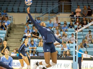 UNC freshman middle blocker Skyy Howard (8) spikes the ball during the Tar Heels' 3-1 win against the Colgate Raiders on Saturday, Sept. 21, 2019 in Carmichael Arena in Chapel Hill.