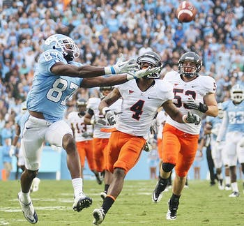 Wide receiver Jheranie Boyd reaches for a deep throw by tailback A..J. Blue in the second quarter of Saturday's ACC matchup against Virginia.