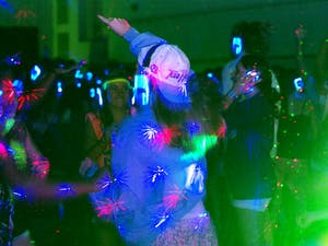 Over 400 UNC students attended the Resident Housing Association Silent Disco in Fetzer Hall on Saturday, in which students were given wireless headphones and could choose between two DJ's, good ratio and Emma Rich.
