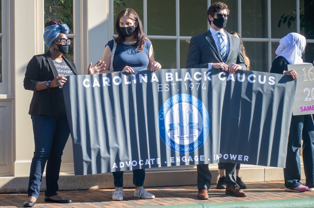 Members of the Carolina Black Caucus stand outside of the Carolina Inn to protest the UNC decision to deny tenure to Nikole Hannah-Jones on Thursday May 20, 2021 before the UNC Board of Trustees meeting.