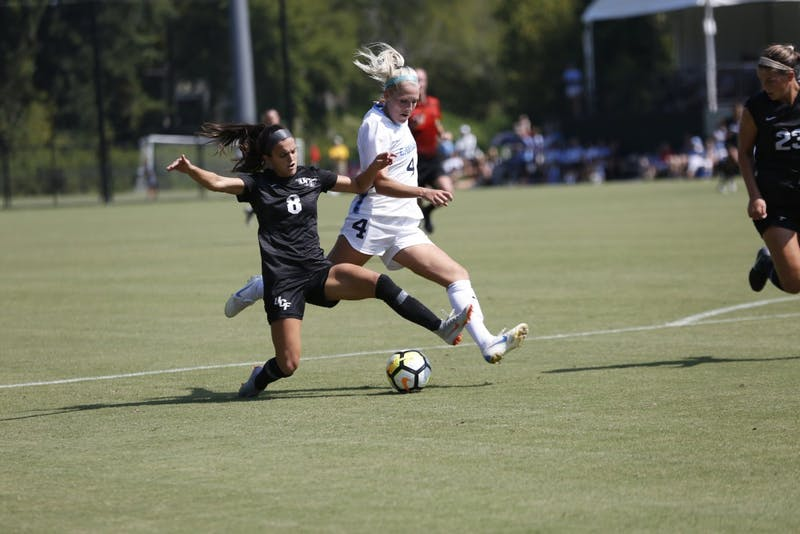 UNC's Bridgette Andrzejewski (4) attempts to shoot against opposing UCF defender Anyssa Ibrahim (8).