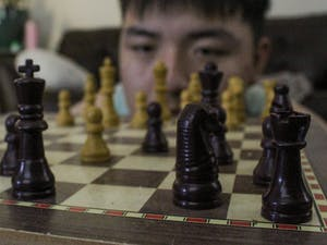High-school student, Steven Zheng, spends his leisure time playing chess during an evening on Oct. 8, 2020.