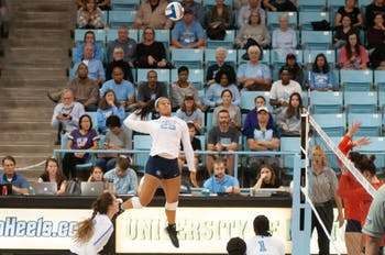 UNC redshirt first-year Lauren Harrison (25) jumps for the ball at the game against Syracuse on Friday, October 26th in the Carmichael Arena. UNC won 3-1.