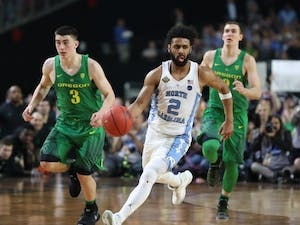 North Carolina guard Joel Berry (2) dribbles up court against Oregon in the teams' Final Four matchup on Saturday in Phoenix.