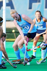 UNC back Nina Notman (10) protects the ball in the offensive zone.