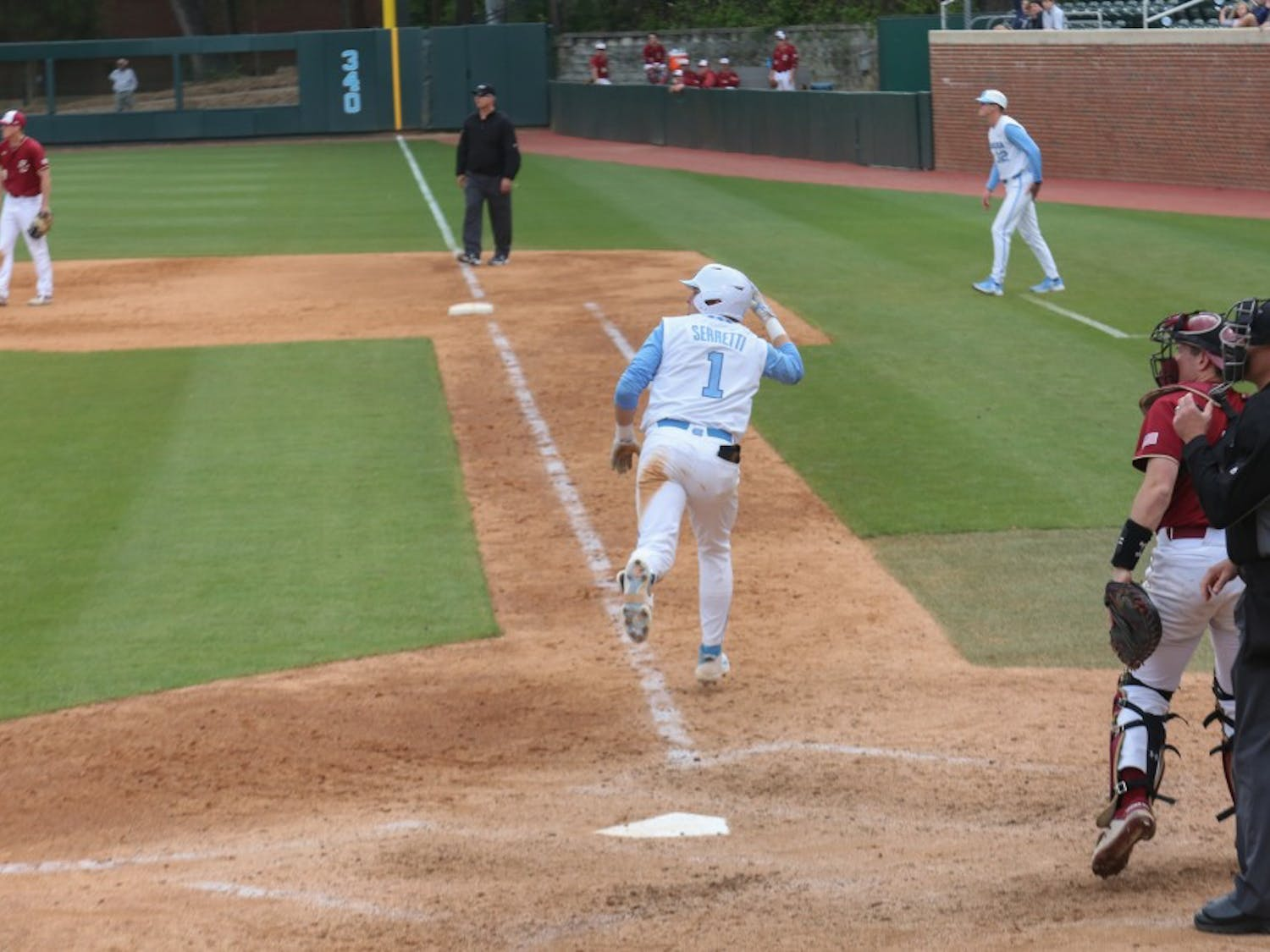 First-year Danny Serretti (1) heads for first base during the Tar Heels' third baseball game against Boston College on Easter weekend.