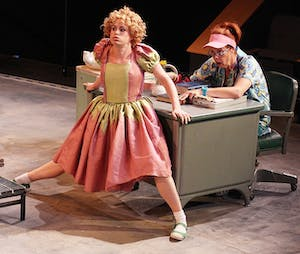 """Katie Paxton as Little Angel and Julie Fishell as the nurse rehearse David Ball's adaption of """"Imaginary Invalid"""" at the Paul Green Theatre."""