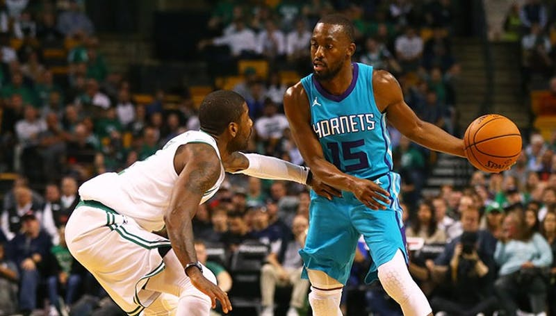 Charlotte Hornet's guard Kemba Walker is guarded by Kyrie Irving of the Boston Celtics. Photo Courtesy of the Hornets