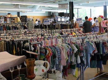 Shoppers browse at PTA Thrift Store on W Main St. on Saturday.