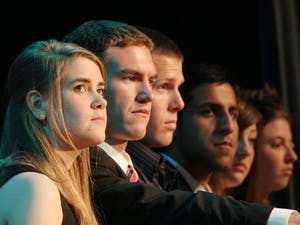 The Cooper administration listens attentively to the various speeches given at Inauguration Tuesday in the Great Hall.